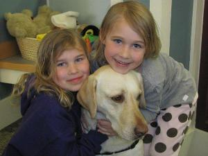 Girls Reading to Dogs @ the Library